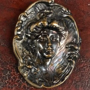 Antique Metal Repousee Woman's Head early clasp